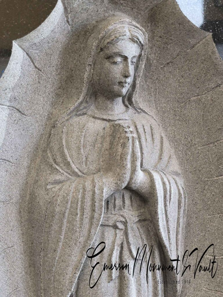hand carved bass relief Lady Guadalupe memorial